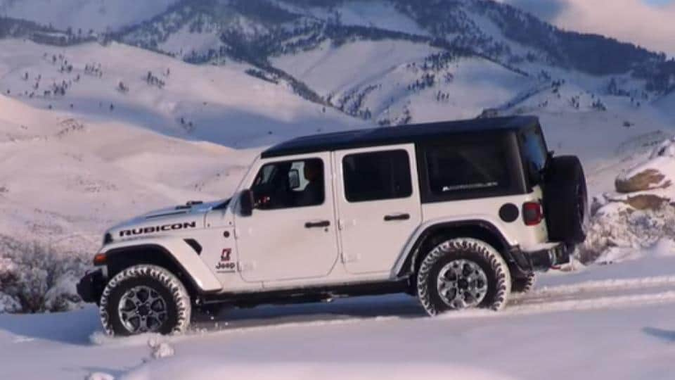 jeep wrangler driving in snow