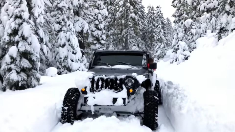 jeep wrangler in a deep snow